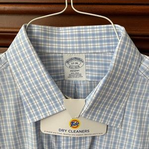 Brooks Brothers open collar blue-check shirt.